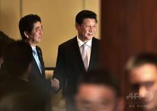 透ける本音:なぜ中国は安倍首相訪中を促したか