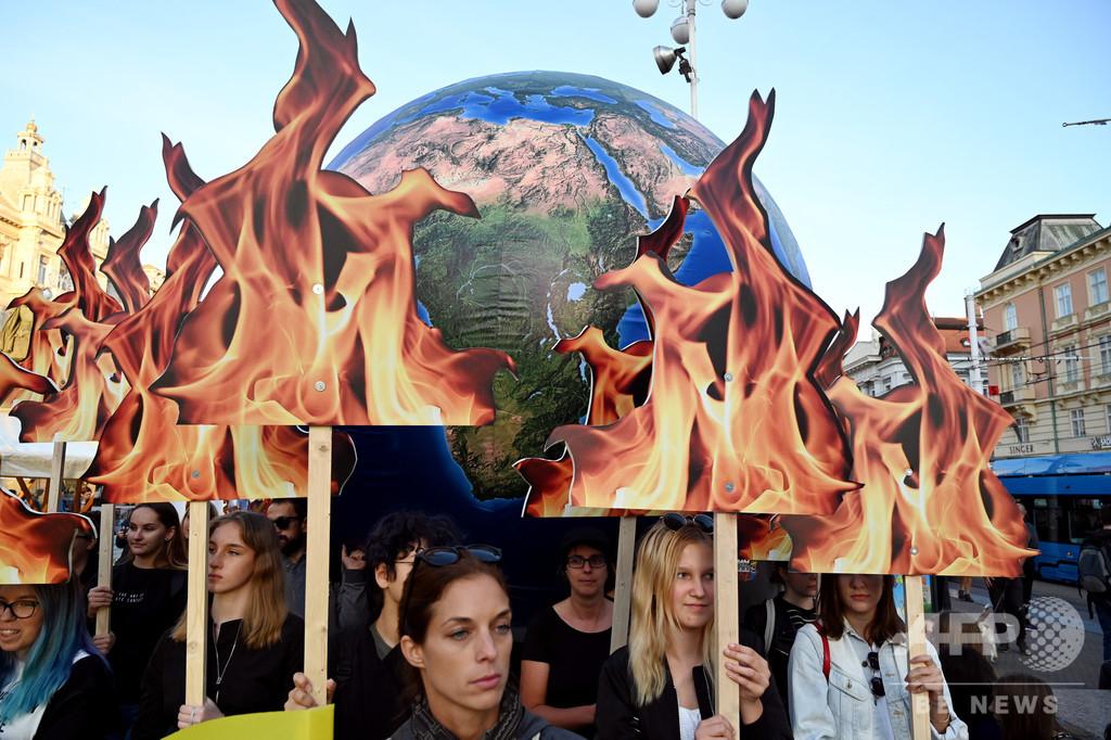 【今日の1枚】火中の地球、差し迫る危機