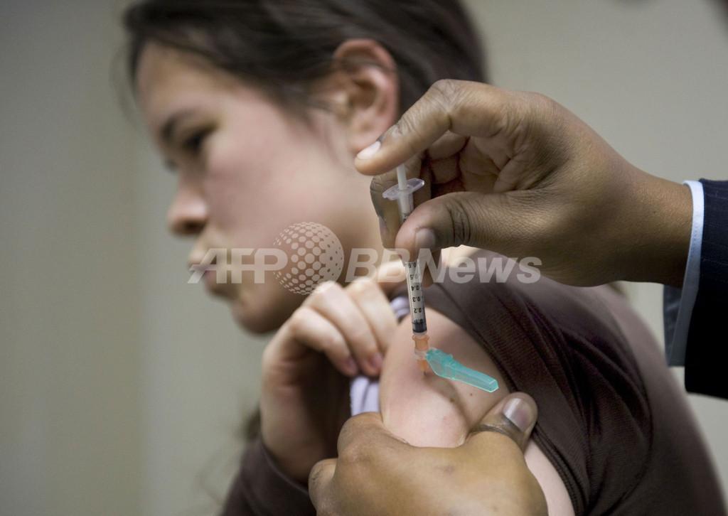 新型インフル、有給取れず出勤する感染者に懸念 米国