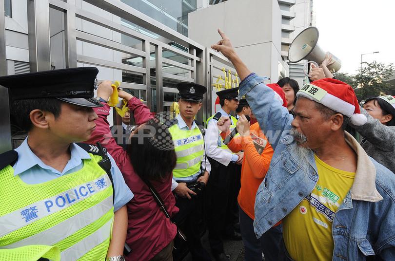 中国の改革訴えた人権活動家に懲役11年、「08憲章」起草の劉暁波氏