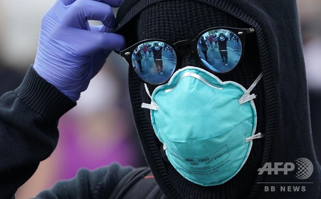 WHO、マスク指針を転換 密接場面で着用推奨