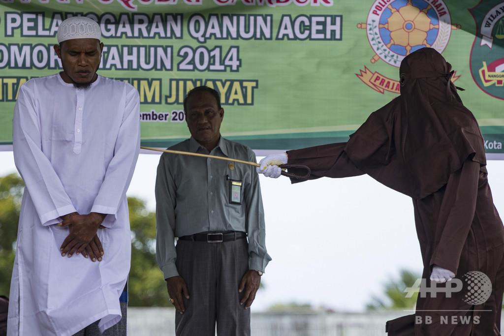 未成年少女と婚外交渉、男2人にむち打ち100回の刑 インドネシア