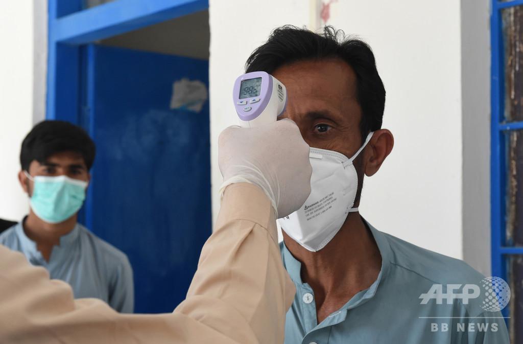 【解説】世界に広がる新型コロナウイルス、検出システムの問題浮き彫りに