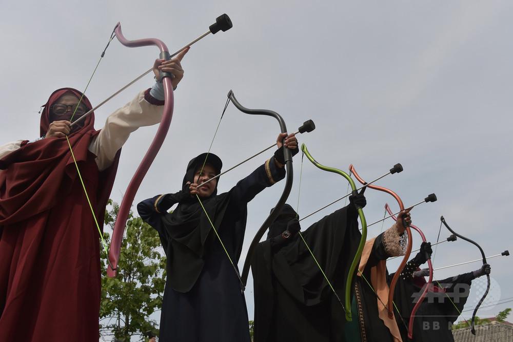信仰を深め、偏見と闘う イスラム教徒女性の「ニカブ隊」 インドネシア