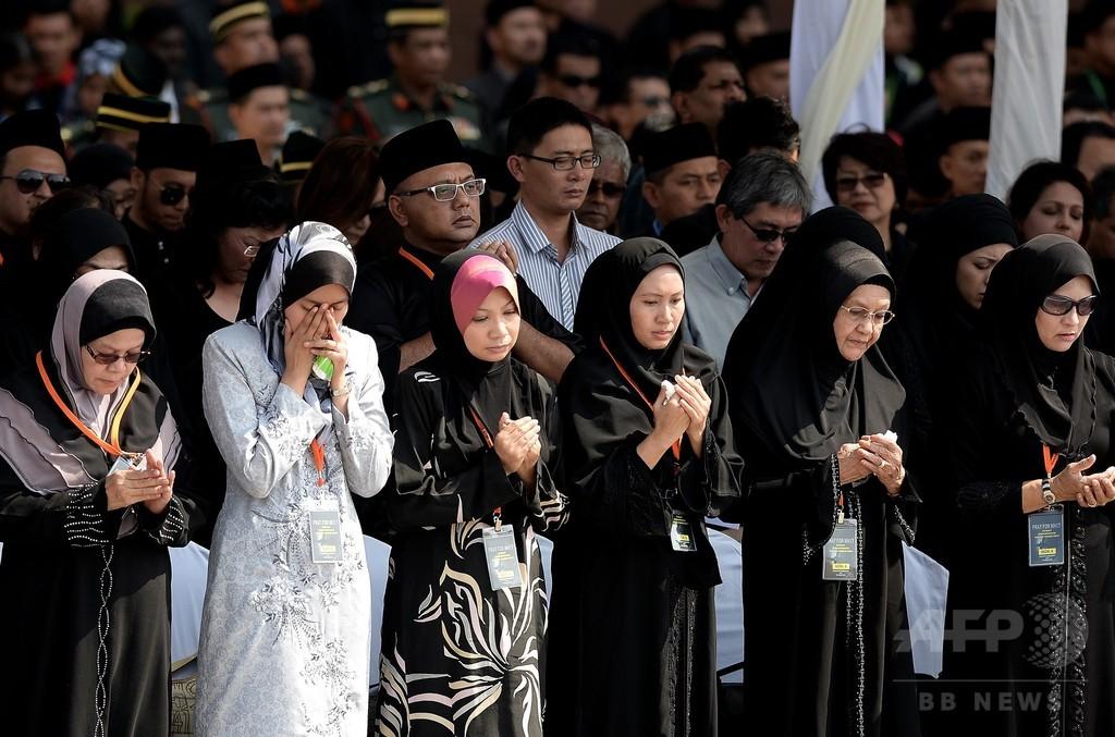MH17便のマレーシア人犠牲者の遺体が帰国
